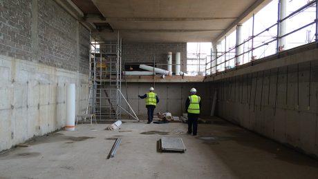 Workmen in a basement