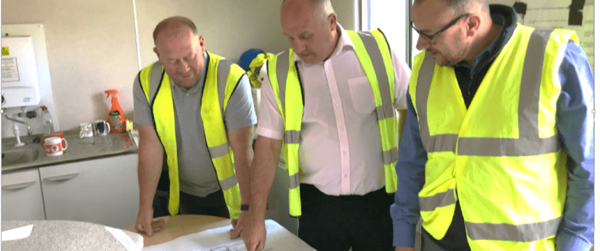 Waterproofing Design Specialists looking at a plan