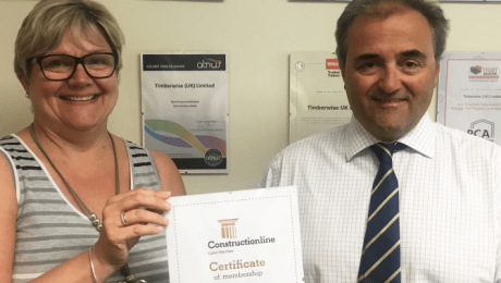 2 people holding a certificate