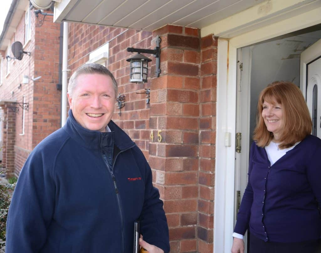 Nottingham surveyor greeting a homeowner at the door