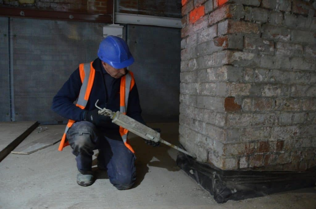 Injecting a damp proof course into a wall
