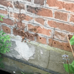 Holes drilled into brickwork