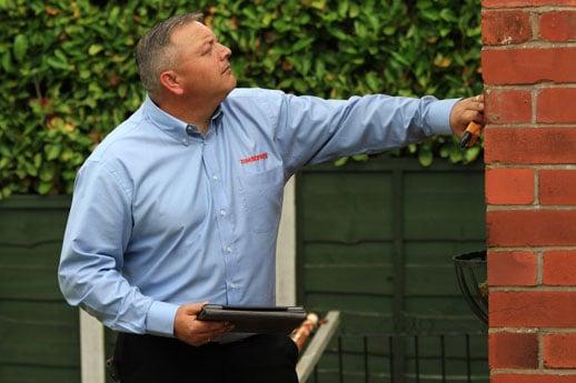 Surveyor providing a damp survey