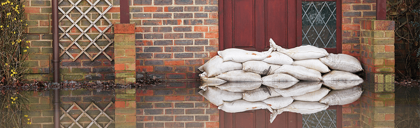 Sand bags outside a property