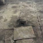 floor of the basement with a broken tile
