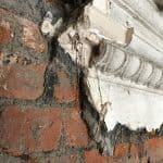 Close up of damaged plaster work on a wall