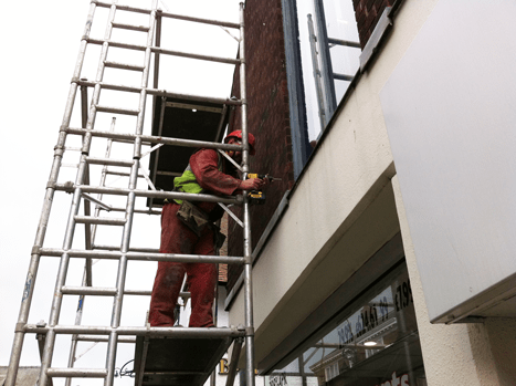 Inserting a cavity wall tie