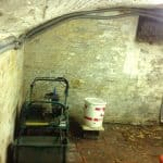 The basement prior to waterproofing, previously used as storage.