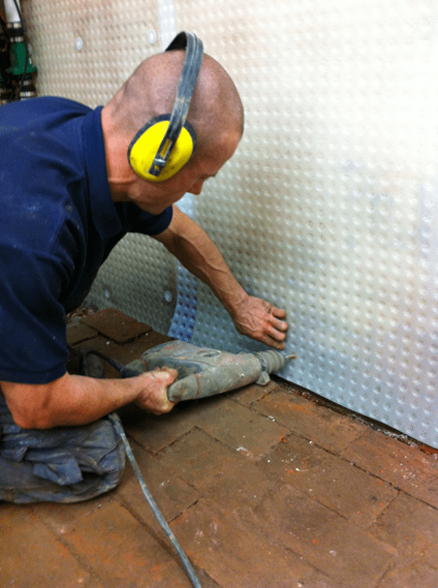 Installation of the new cavity drain membrane