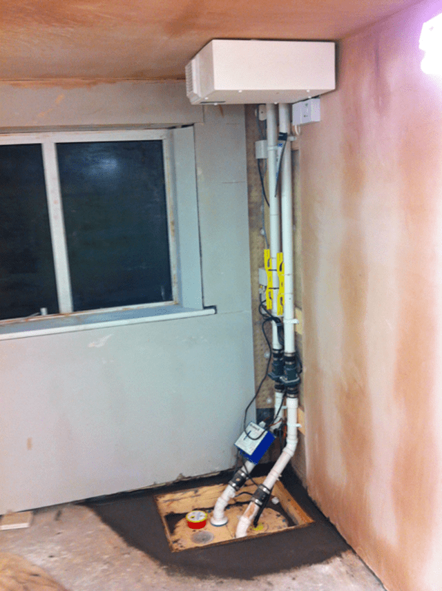 New basement sump and pump installed along with a positive pressure system