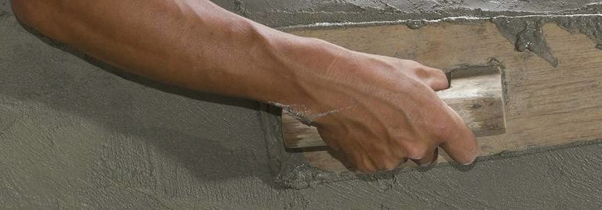 Plastering damp walls