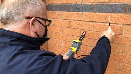 Surveyor conducting a cavity wall tie survey
