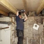 Technician replacing timber