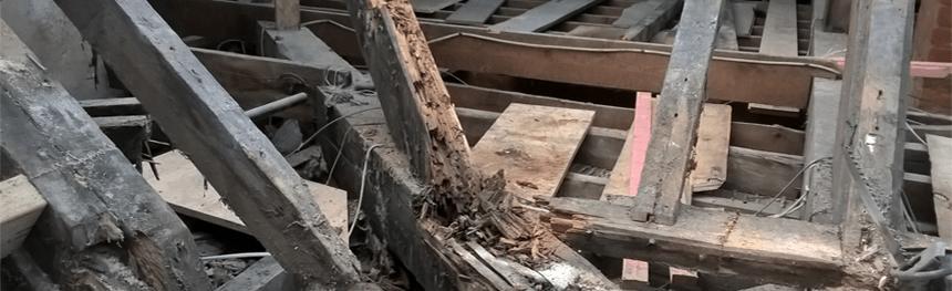Damaged beams in need of repair