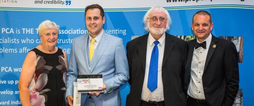 Surveyor collecting an award at the PCA awards