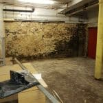 Damp basement with exposed brickwork