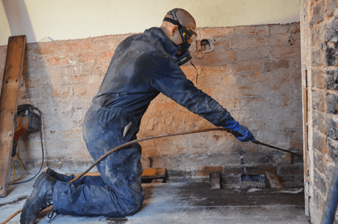 Man treating timbers for woodworm