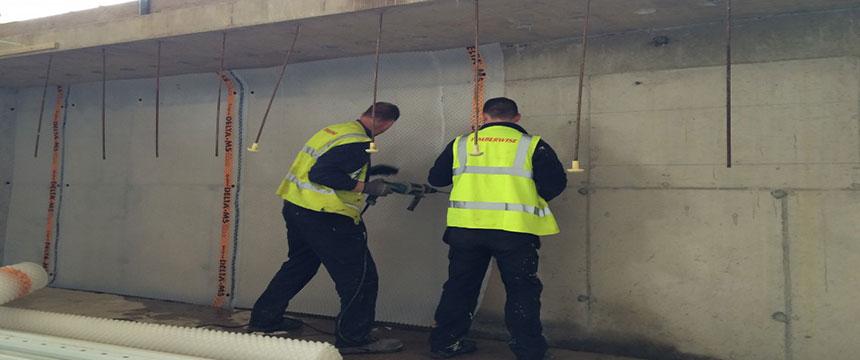 basement waterproofing applied onto walls