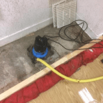 Pumping out water in a room