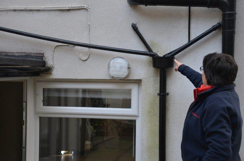 surveyor identifying penetrating damp at property