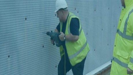 technician installing damp proof membrane